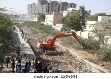 KARACHI, PAKISTAN - DEC 17: Demolishing illegal encroachment during anti encroachment drive to clear the land of Pakistan Railways under the supervision of KMC on December 17, 2018 in Karachi.