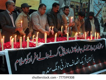 KARACHI, PAKISTAN - DEC 18: Activists of Tehreek-e-Insaf (PTI) holding candle light vigil  in commemoration of Quetta Church attack victims, on   December 18, 2017 in Karachi.