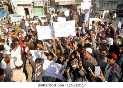 KARACHI, PAKISTAN - DEC 20: Residents of Hazara Colony are holding protest  demonstration against high handedness of Railway Department, at Kala Pull area  on December 20, 2018 in Karachi.
