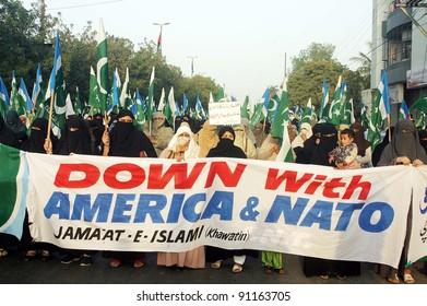 KARACHI, PAKISTAN - DEC 20: Women supporters of Jamat-e-Islami (JI) Women Wing pass through a road during Tahafuz-e-Pakistan Khawateen rally in Karachi, Pakistan on December 20, 2011.