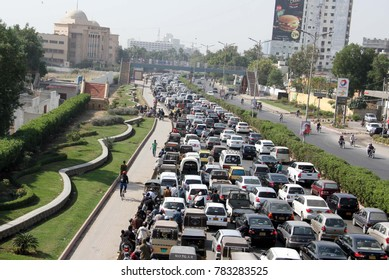 KARACHI, PAKISTAN - DEC 28: A large numbers of vehicles stuck in traffic jam due to construction work at Shahrah-e-Faisal road in Karachi on December 28, 2017.
