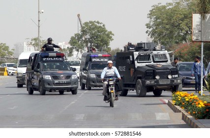 KARACHI, PAKISTAN - FEB 06: Security and law enforcement personnel cordon of area in surrounding of Afghan consulate after firing incident on February 06, 2017 in Karachi.