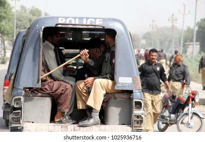 KARACHI, PAKISTAN - FEB 15: Police official arrest a protesters during protest demonstration of Dairy farmers for increasing in the milk price at National Highway road on February 15, 2018 in Karachi.