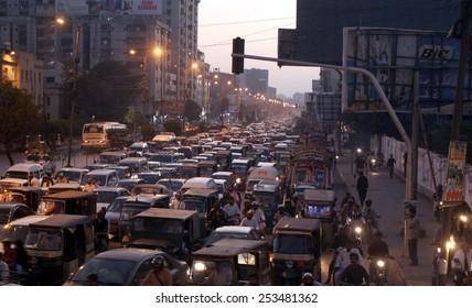 KARACHI, PAKISTAN - FEB 17: Numerous vehicles stuck in traffic jam due to closure of way leads towards Numaish Chowrangi in perception of protest of Shikarpur blast  on February 17, 2015 in Karachi.