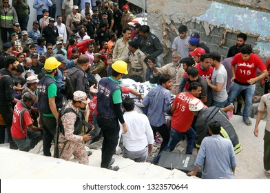 KARACHI, PAKISTAN - FEB 25: Rescue officials are busy in rescue operation at the site of building collapse incident at Jaffer-e-Tayyar Society located on Malir area on February 25, 2019 in Karachi.