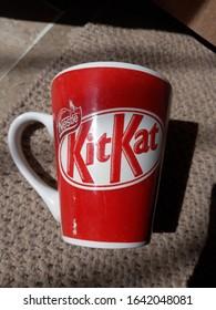 Karachi, Pakistan - February 11,2020: Beautiful red kitkat coffee cup/mug placed in the sunlight.