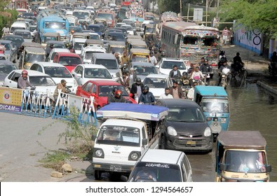 KARACHI, PAKISTAN - JAN 24: Traffic jam due to closed of University road for construction work, showing negligence of concerned authorities, near Jail road on January 24, 2019 in Karachi.