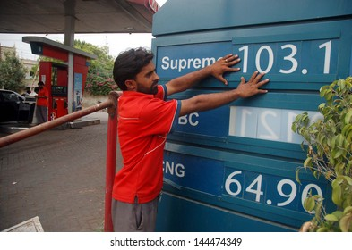 KARACHI, PAKISTAN - JUL 01:Employee displays new prices of petroleum  products at a fuel station on July 01, 2013 in Karachi. The oil prices are expected to be increase by up to Rs3.66 per liter
