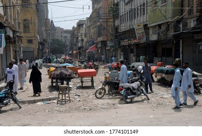 KARACHI, PAKISTAN - JUL 11: Closed shops at a market while business activities shutdown during smart lockdown imposed government due to increasing in coronavirus cases, on July 11, 2020 in Karachi.