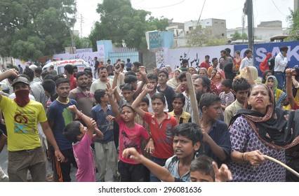 KARACHI, PAKISTAN - JUL 13: Residents of Landhi are protesting against detention of their relatives during police search operations, outside Landhi Police Station on July 13, 2015 in Karachi.