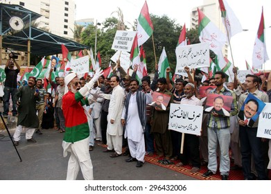 KARACHI, PAKISTAN - JUL 14: MQM chant slogans against remarks of Federal Interior Minister, and high handedness of rangers officials on July 14, 2015 in Karachi.  (S.Imran Ali/PPI Images).