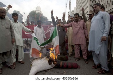 KARACHI, PAKISTAN - JUL 20: Activists of Sunni Tehreek burn effigy and India flag as they are protesting against brutality of Indian Army in Kashmir during demonstration on July 20, 2016 in Karachi.