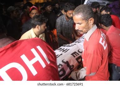 KARACHI, PAKISTAN - JUL 21: Dead bodies of police staffs killed by unidentified gunmen in Korangi area being shifted to Jinnah Hospital, on July 21, 2017 in Karachi.