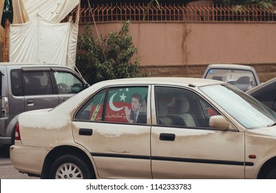 KARACHI, PAKISTAN: July 25: Pakistan Tehreek-e-Insaf (PTI) party supporters on the streets of Karachi, Pakistan. Pakistan's national elections took place on July 25th, 2018.