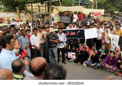 KARACHI, PAKISTAN - JUN 01: Journalists are protesting against license cancellation of  newly upcoming media group BOL Networks, during a demonstration on June 01, 2015.