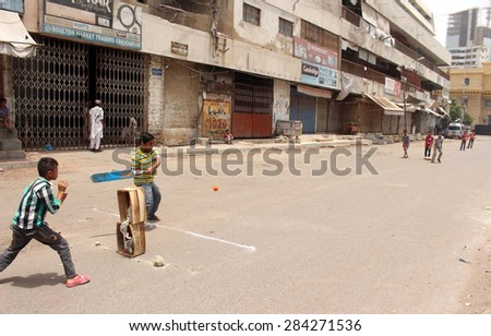 Karachi Pakistan Jun 04 Children Are Playing Cricket On Vacant Road During The