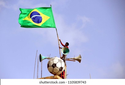 KARACHI, PAKISTAN - JUN 04: Youth installing flag of Brazil Football team on the roof of a building ahead of the start of FIFA World Cup 2018, on June 04, 2018 in Karachi.