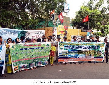 KARACHI, PAKISTAN - JUN 05: Students of Federal Urdu University take part in an awareness rally on occasion of the World Environment Day at Karachi press club on June 05, 2011 in Karachi.