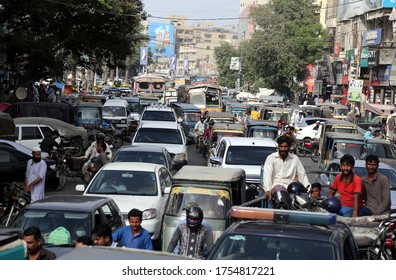 KARACHI, PAKISTAN - JUN 12: Numerous vehicles are stuck in traffic jam due to negligence of traffic police staffs and illegal parking, after government eased a  lockdown on June 12, 2020 in Karachi