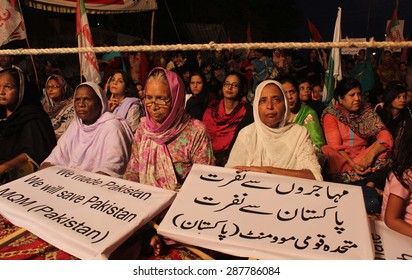 KARACHI, PAKISTAN - JUN 16: Activists of MQM are protesting against statement of Federal Minister of Defence Khuwaja Asif about Mohajirs, outside Karachi press club on June 16, 2015.