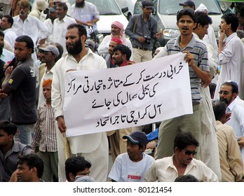 KARACHI, PAKISTAN - JUN 28: Supporters of All Karachi Tajir Ittehad are protesting against electricity load-shedding during rally on June 28, 2011in Karachi, Pakistan.