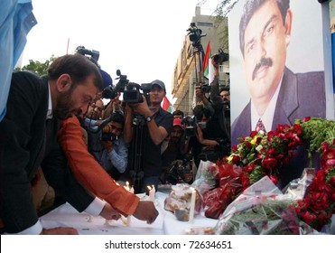 KARACHI, PAKISTAN - MAR 06: Muttehda Qaumi Movement (MQM) leader, Dr.Farooq Sattar lightens candles in front of poster of slain Federal Minister, Shahbaz Bhatti on March 06, 2011 in Karachi.