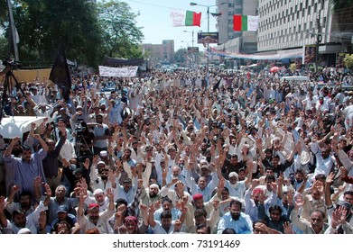 KARACHI, PAKISTAN - MAR 14: Karachi Electric Supply Company reinstated employees chant slogans against KESC administration during a protest demonstration at press club on March 14, 2011 in Karachi.