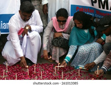 KARACHI, PAKISTAN - MAR 16: Justice and Peace Commission of Pakistan are enlightening candles while a protest against suicidal blast occurred at two Churches of Lahore on March 16, 2015 in Karachi.