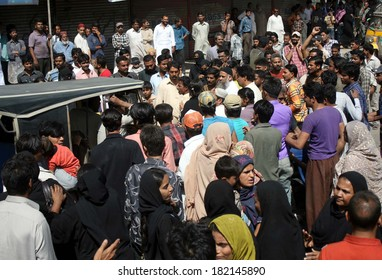 KARACHI, PAKISTAN - MAR 17: People are protesting against court order to vacant  government property which grabbed by mafias and settled into colonies, near Liaquatabad area on March 17, 2014 Karachi.