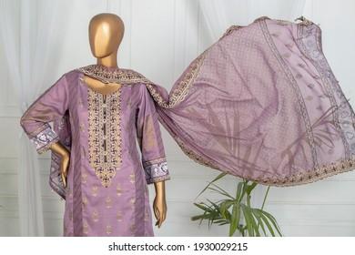 Karachi, Pakistan - March 05, 2021: Mannequin dressed in Pakistani fashion salwar kameez in display. Fashion Concept