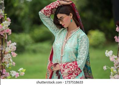 Karachi, Pakistan: May 02, 2020: Beautiful trendy woman in designer dress. posing in studio. Fashion concept