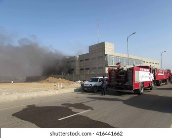 KARACHI, PAKISTAN - MAY 06: Smoke rising from brush manufacturing factory caught fire as the fire brigade staffs are busy in extinguishing fire, at Korangi Crossing area on May 06, 2016 in Karachi.