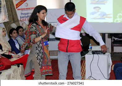 KARACHI, PAKISTAN - MAY 07: Female volunteer of Pakistan Red Crescent Society gives presentation on First Aid during Training Workshop arranged by Pakistan Red Crescent on May 07, 2015 in Karachi.