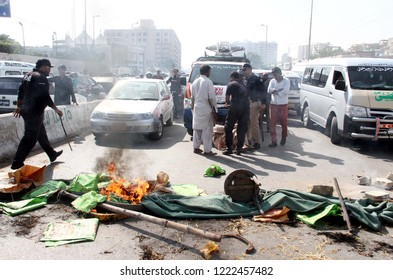 KARACHI, PAKISTAN - NOV 05: Affected people of anti-encroachment department block road as they are holding protest against KMC after demolishing illegal encroachment on November 05, 2018 in Karachi.