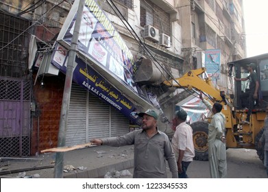 KARACHI, PAKISTAN - NOV 06: Demolishing illegal encroachment during anti encroachment drive under the supervision of KMC over directions of SCP orders, on November 06, 2018 in Karachi.