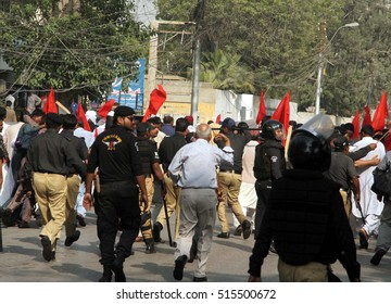 KARACHI, PAKISTAN - NOV 14: Police arresting protesters belonging to Irrigation  Department of Sindh and were trying to get enter into Red Zone area, on November 14, 2016 in Karachi.