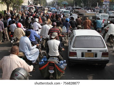 KARACHI, PAKISTAN - NOV 16: Motorists stuck in traffic jam during protest of Lady Health workers outside CM House on November 16, 2017 in Karachi.