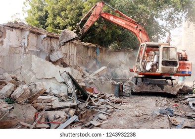 KARACHI, PAKISTAN - NOV 28: Demolishing illegal encroachment during anti encroachment drive under the supervision of KMC over directions of Supreme Court orders, on November 28, 2018 in Karachi.