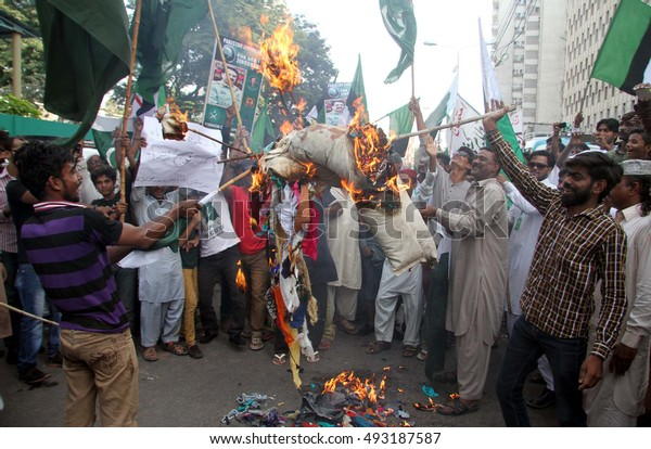 KARACHI, PAKISTAN - OCT 04: Butcher community members are holding a protest  demonstration against India, on October 04, 2016 in Karachi.