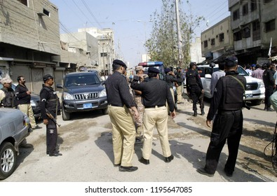 KARACHI, PAKISTAN - OCT 04: Security officials stand alert to avoid untoward incident during operation against Lyari Gang War Leader, Ghaffar Zikri, at Lyari on October 04, 2018 in Karachi.