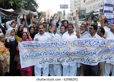 KARACHI, PAKISTAN - OCT 13: Members of All Pakistan Clerks Association (APCA) chant slogans in favor of their demands during a protest demonstration  on October 13, 2010 in Karachi, Pakistan.