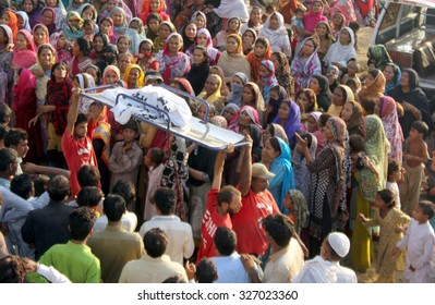 KARACHI, PAKISTAN - OCT 13: Recovered dead bodies after a landslide hit huts in Gulistan Johar Block-1 area of Karachi being shifting to Edhi Morgue on October 13, 2015 in Karachi.