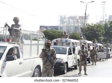 KARACHI, PAKISTAN - OCT 14: Rangers and Sindh Police staffs are jointly holding a flag march to maintain law and order situation during the month of Moharram-ul-Haram on October 14, 2015 in Karachi.