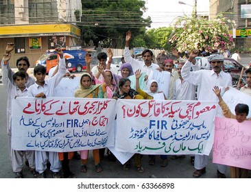 KARACHI, PAKISTAN - OCT 19: Residents of Gulzar Hijri are protesting against their area police during a demonstration on October 19, 2010 in Karachi, Pakistan.