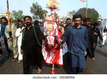 KARACHI, PAKISTAN - OCT 22: Devotees of Hazrat Imam Hussain (A.S) are participating in mourning procession in connection of 8th Moharram-ul-Haram on October 22, 2015 in Karachi.