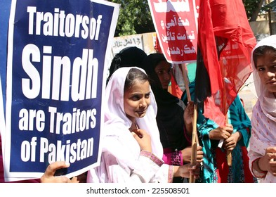 KARACHI, PAKISTAN - OCT 23: Qaumi Awami Tehreek activists are chanting slogans against MQM�¢??s call for the formation of new provinces, during a protest demonstration  on October 23, 2014 in Karachi.