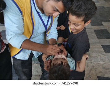 KARACHI, PAKISTAN - OCT 24: Anti polio campaigners are administrating vaccines to children at Karachi Cantt. Station on October 24, 2017 in Karachi.