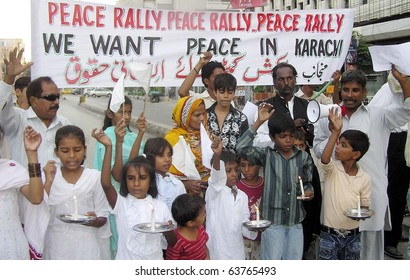 KARACHI, PAKISTAN - OCT 24: Supporters of Action Committee for Human Rights hold lightened candles chant slogans in favor of Peace during a rally  press club on October 24, 2010 in Karachi.