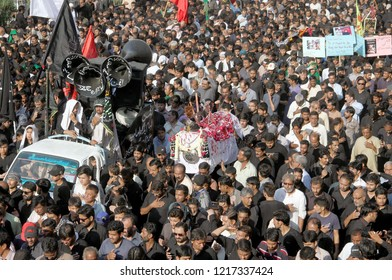 KARACHI, PAKISTAN - OCT 30: Shiite mourners of Imam Hussain (A.S) are participating in religious procession in connection of 40th day (Chehlum), at M.A Jinnah Road on October 30, 2018 in Karachi.
