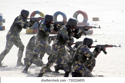 KARACHI, PAKISTAN - SEP 06: Pakistan Navy commandos are exposing their skills during anti terrorism show on the occasion of 52nd Pakistan Defence Day at Seaview Beach on September 06, 2017 in Karachi.